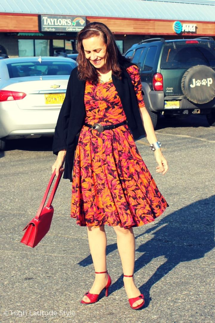 style book author in fit-and-flare print fall dress and cardigan