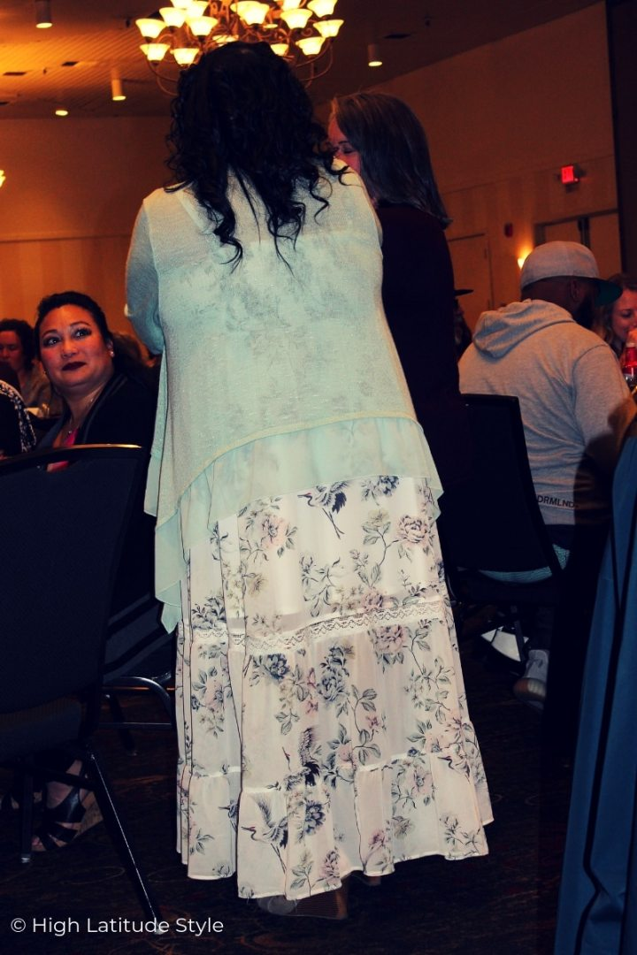 Fairbanksan woman in romantic baby blue floral print on white lace dress with ruffle cardigan