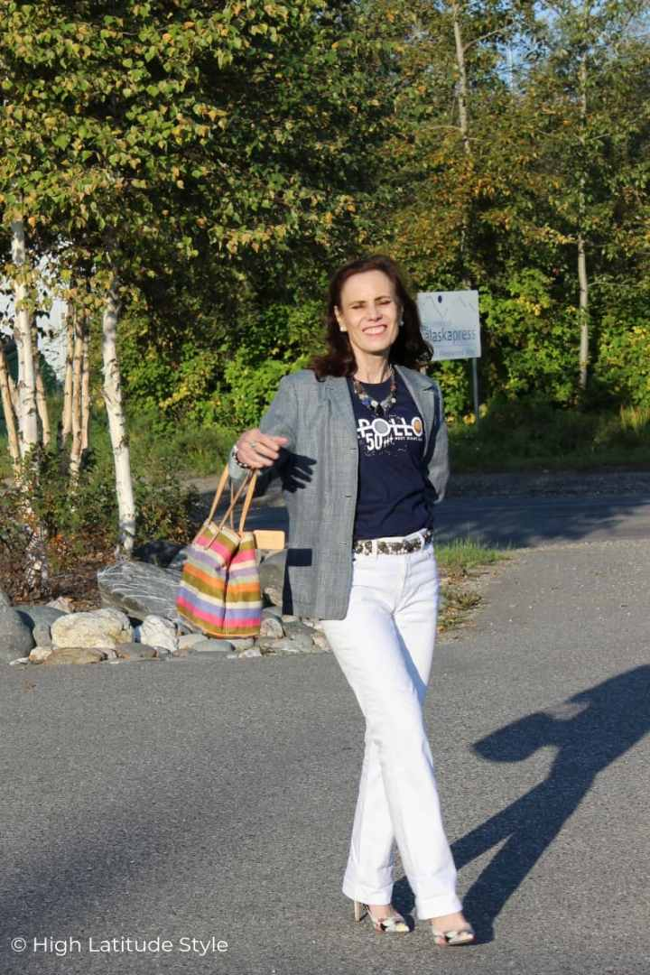 street style blogger in white denim and blue T and blazer after Labor Day