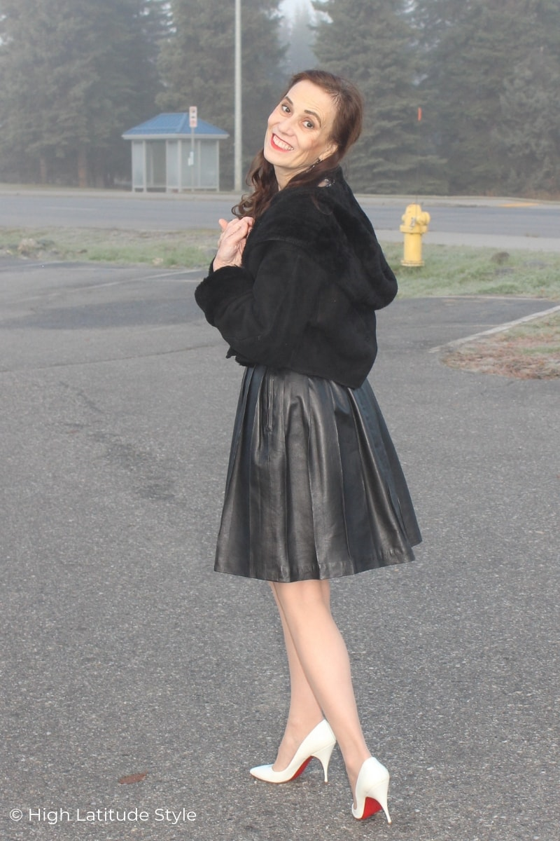 Nicole in leather skirt, shearling cropped coat, pantyhose and heels