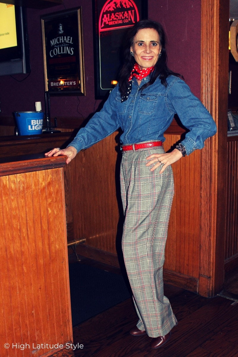 over 50 years old stylist in high rise wide leg pants with denim shirt