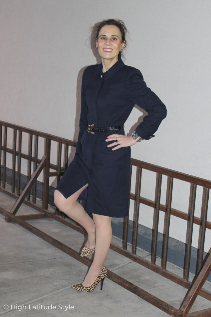 Style blogger in above the knee fitted sleek belted dress and heels