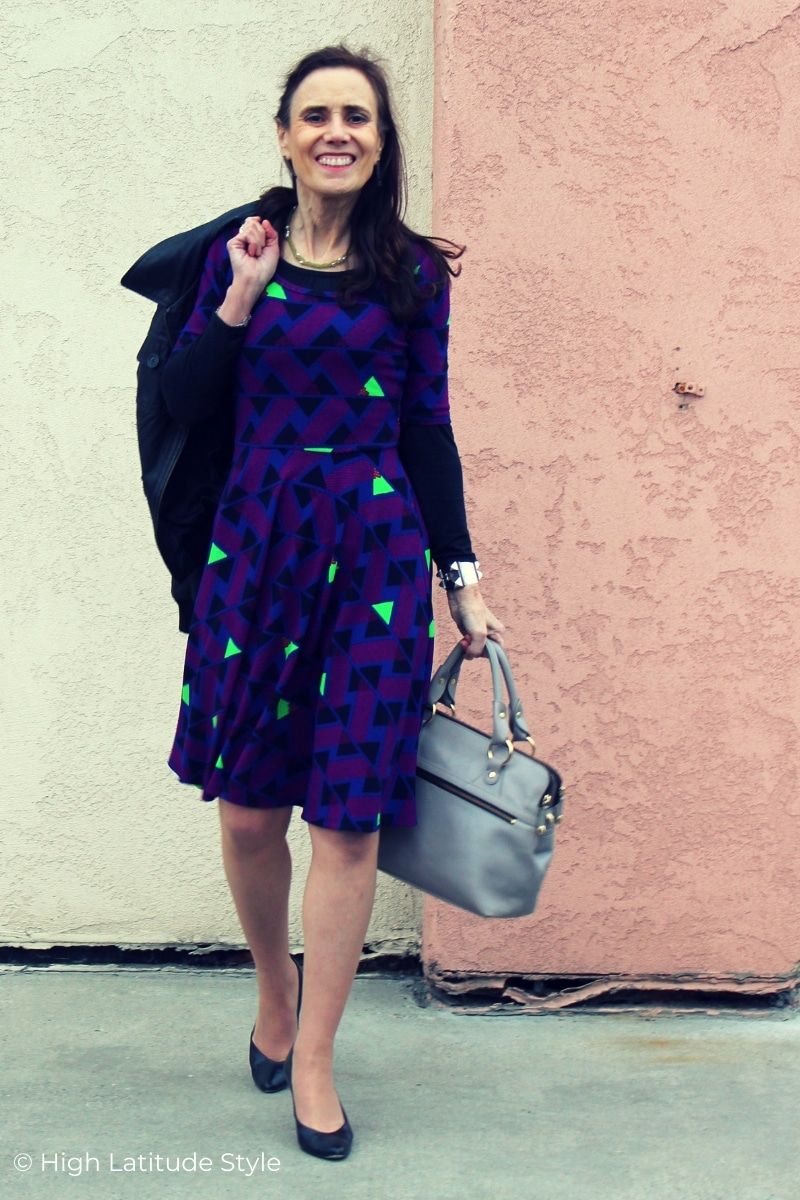 Nicole of High Latitude Style in multi color fall dress and aviator jacket
