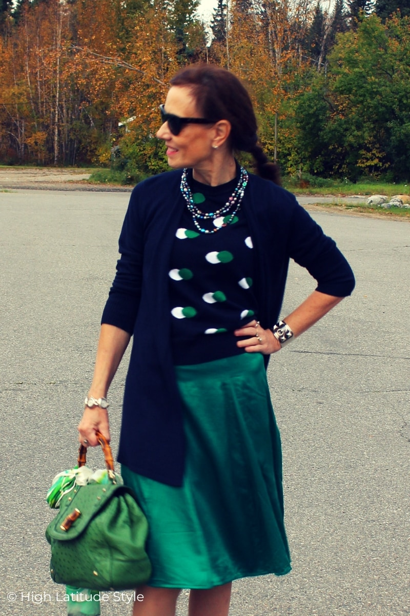 stylist in faux twinset and teal silk skirt