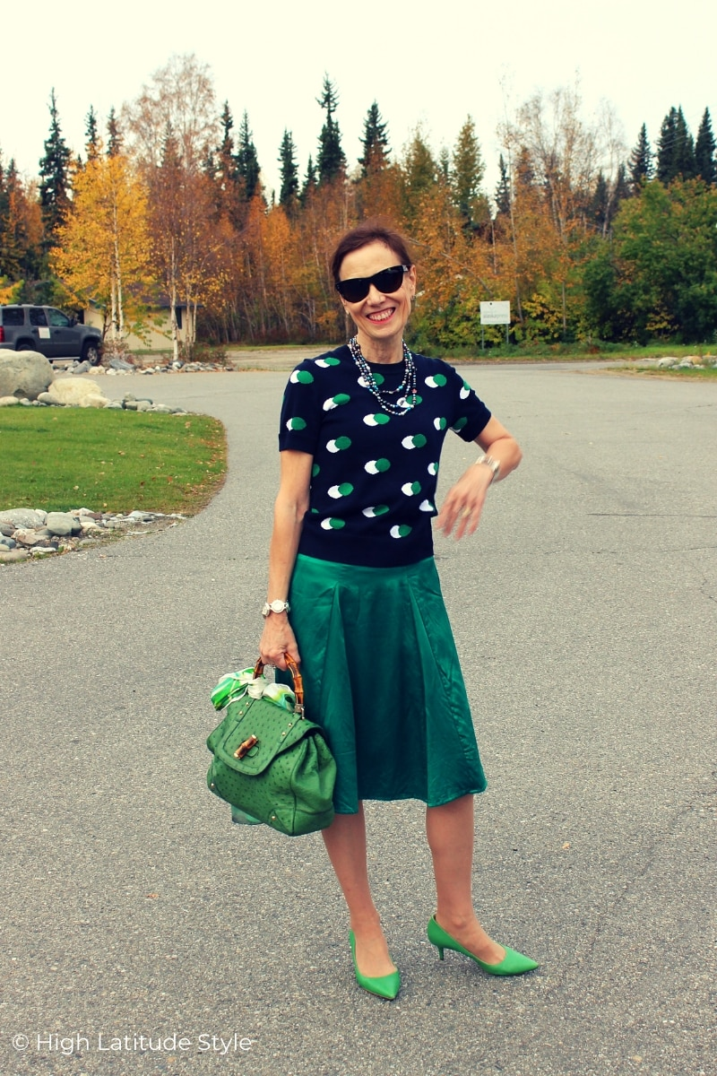 over 50 years old fashion blogger in green and navy skirt sweater fall work look