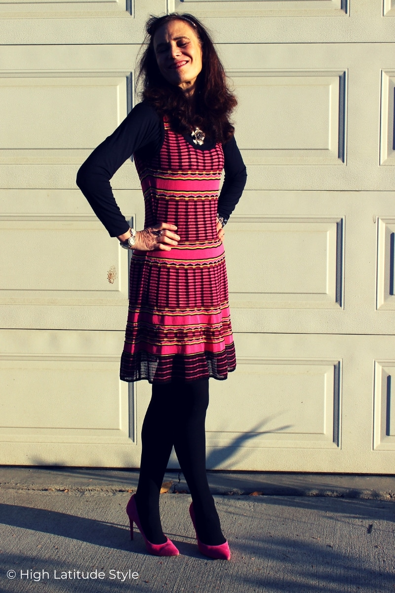 midlife blogger in pink Missoni dress with black tights and pink pumps