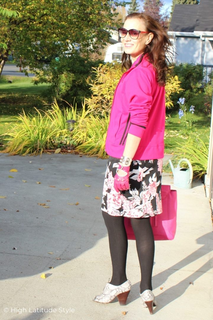 Alaskan blogger in Adidas coat, floral bottom and snakeskin shoes with tights