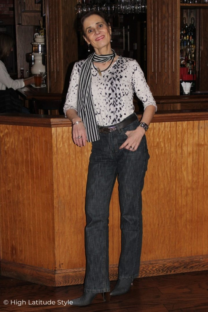 style book author Nicole in bootcut jeans with tucked in sweater