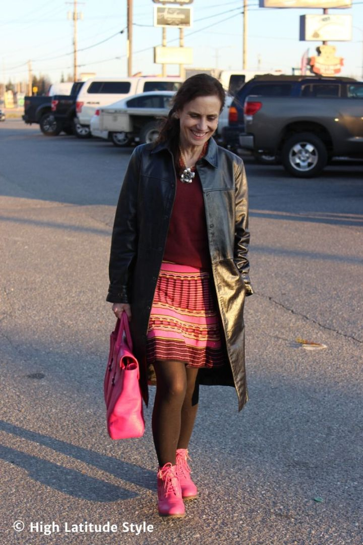 style blogger in leather trench coat, dress as skirt with cardigan as top