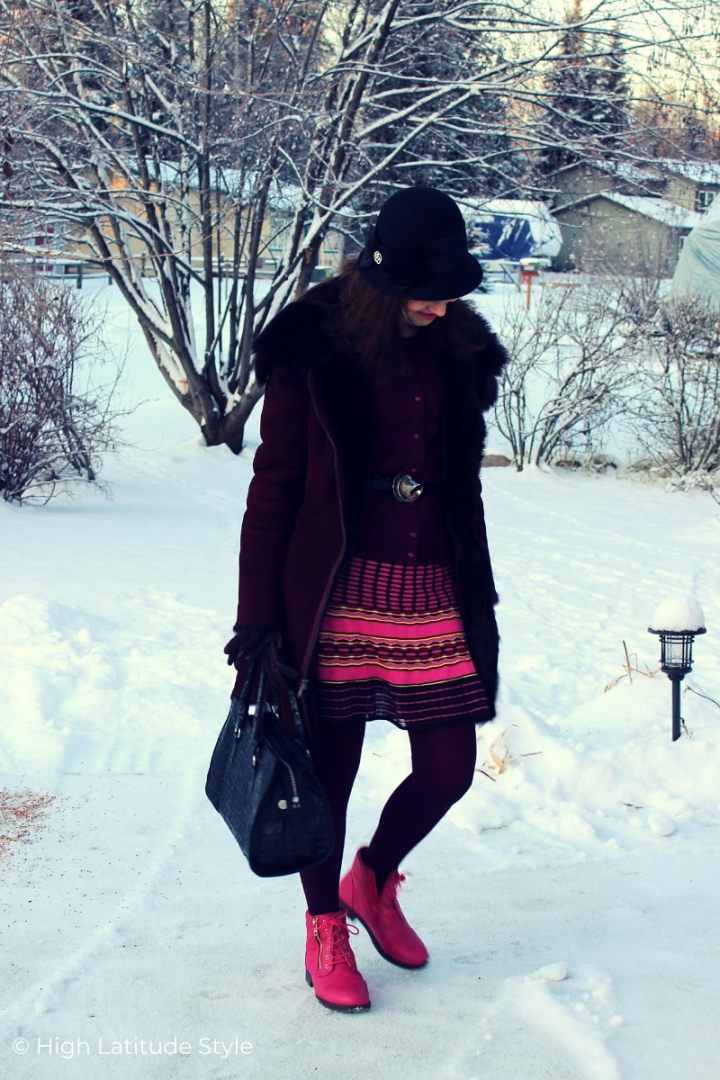 style blogger in burgundy, black pink winter outfit with head gear