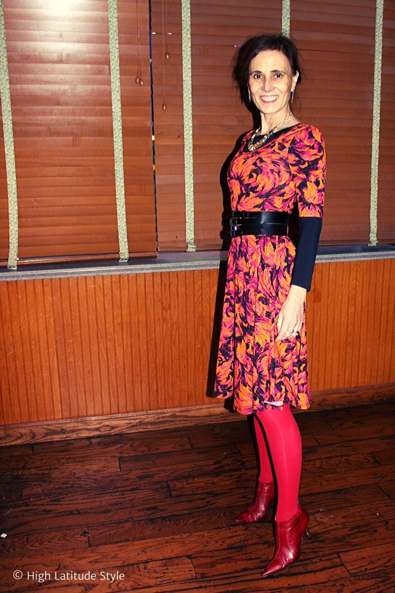 fashion blogger Nicole in orange dress with red tights and black layering top