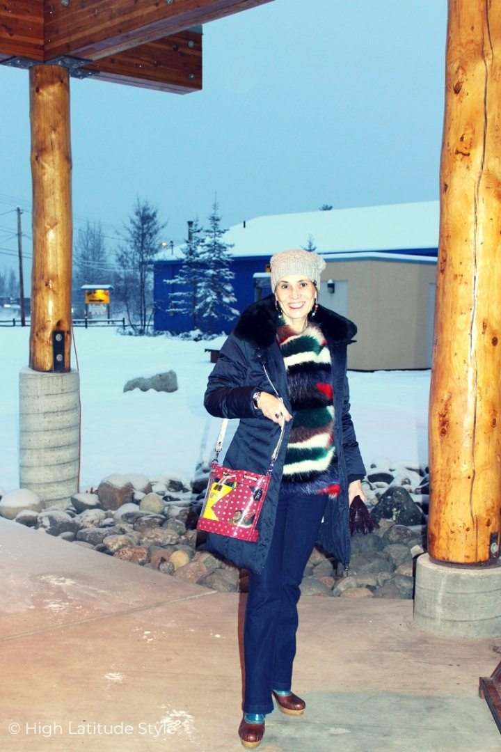 over 50 years old Alaskan woman in outfit to watch a winter sports event