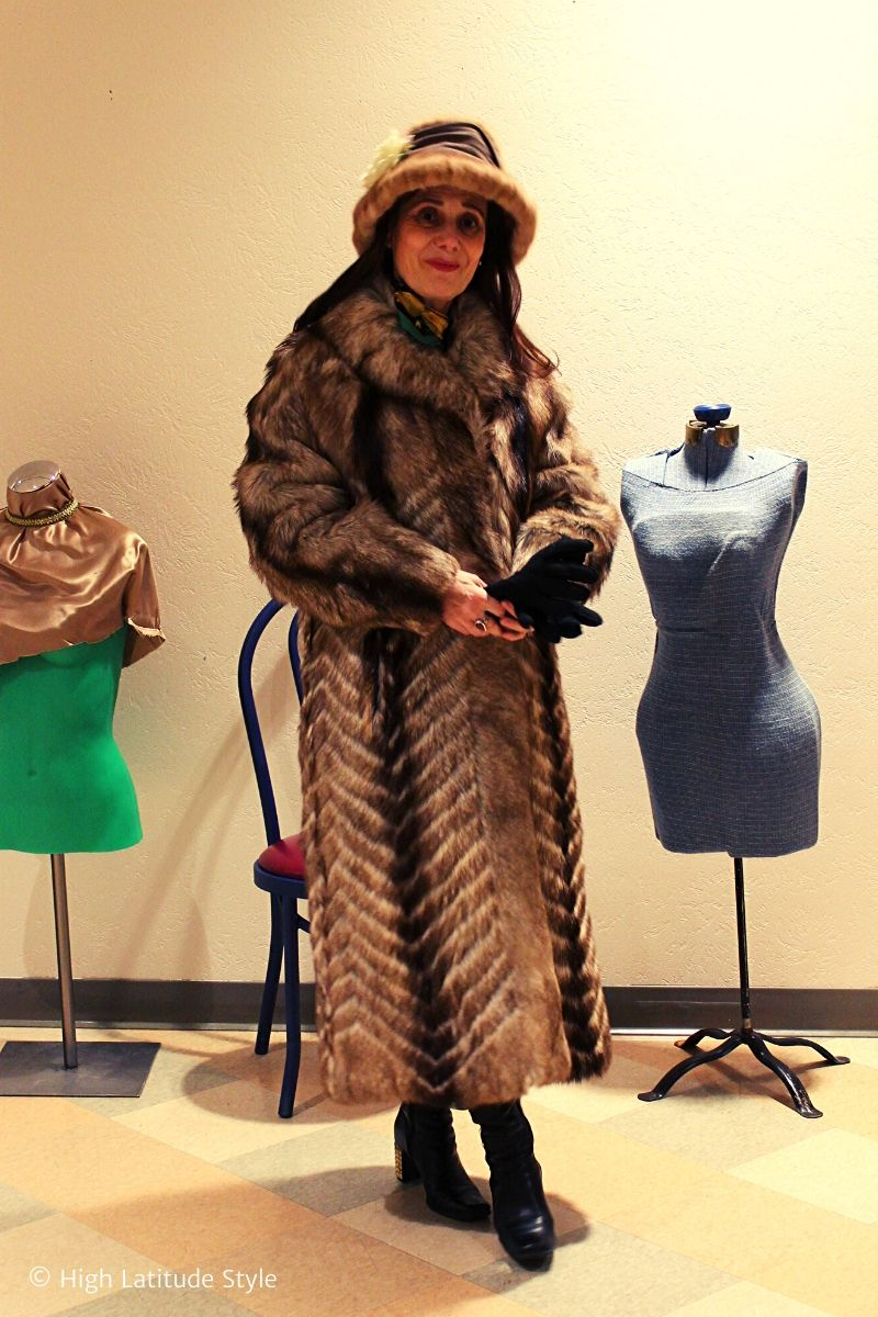 Alaskan stylist in long coat, boots, hat and gloves