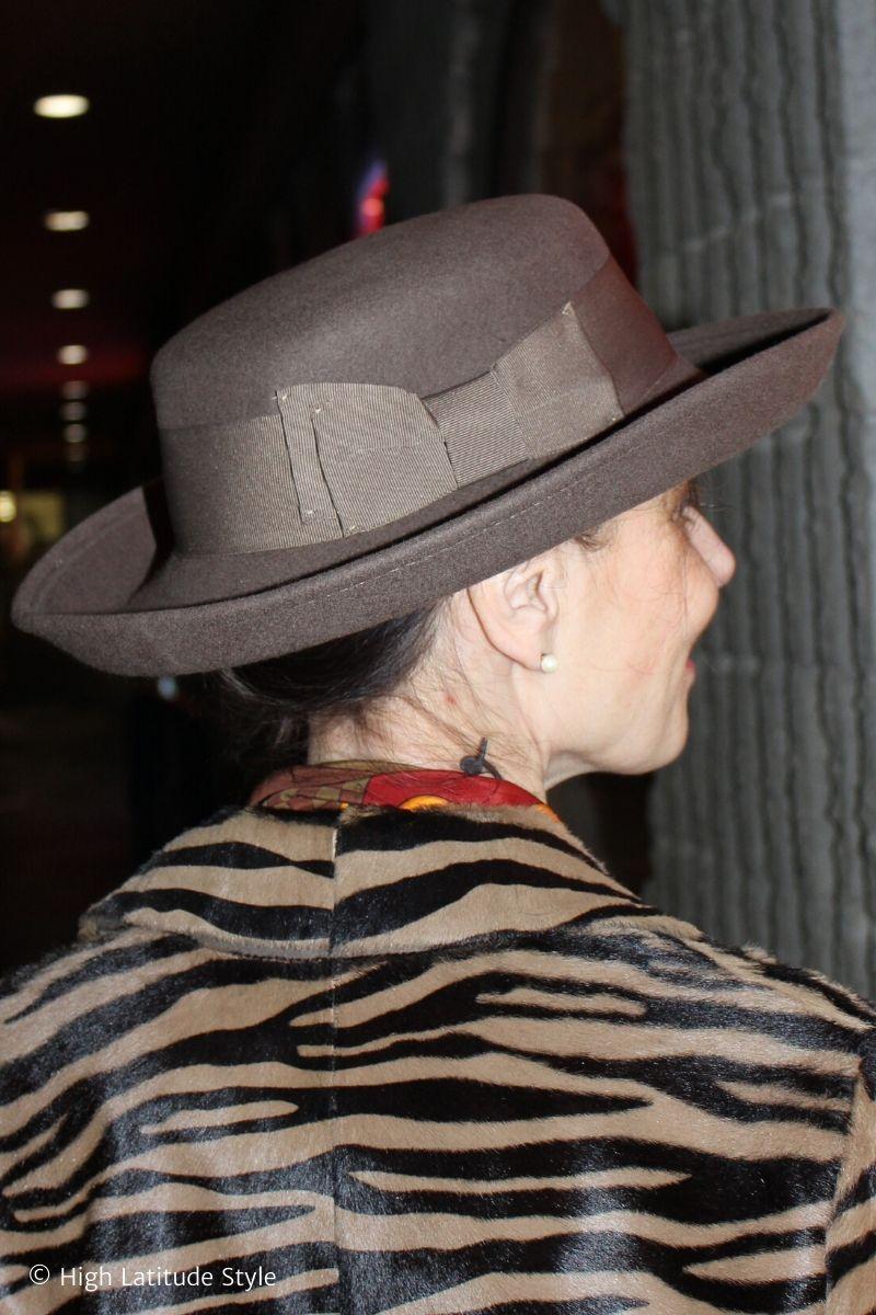 mature woman wearing a felt wool hat