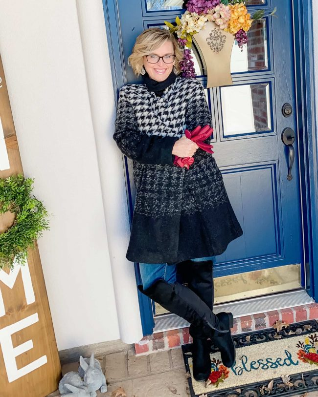 Andrea of Pearls and Pantsuits in jeans, otk boots, turtleneck, houndstooth coat