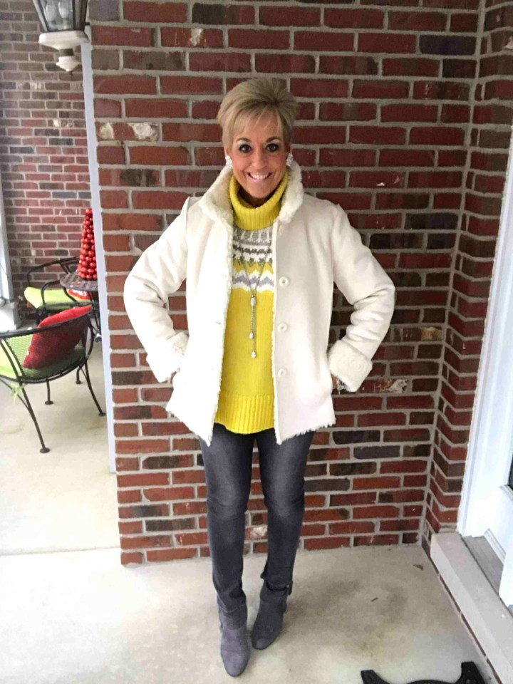 Julie in Fair Isle sweater and jeans layered under a trendy Teddy coat