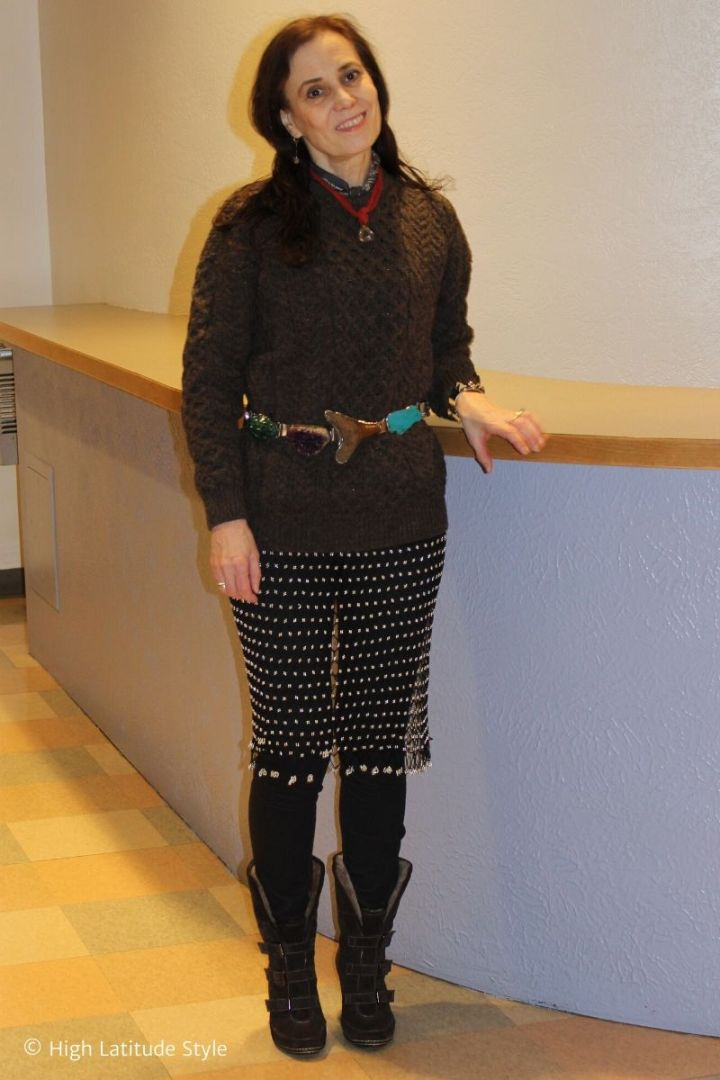style blogger in eclectic look of beaded mesh skirt, jeans, sweater, belt and neckerchief