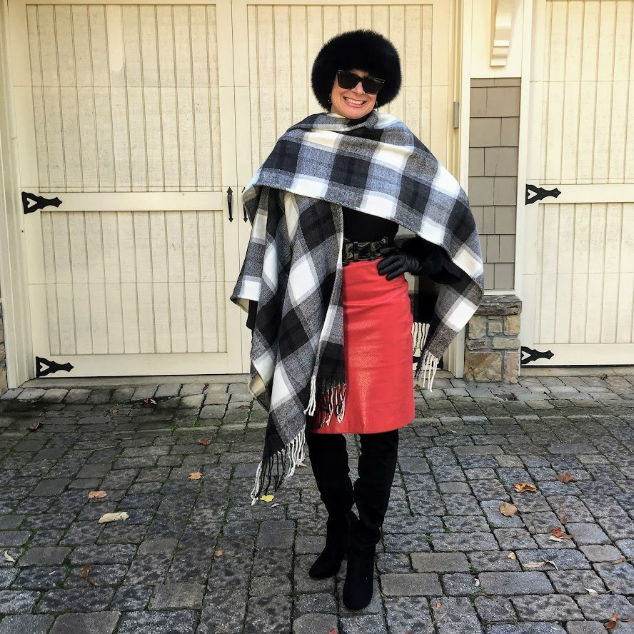 Robin LaMonte of Hello I'm 60ish in red-black-white winter look of hat, leather skirt, sweater, otk-boots, blanket scarf