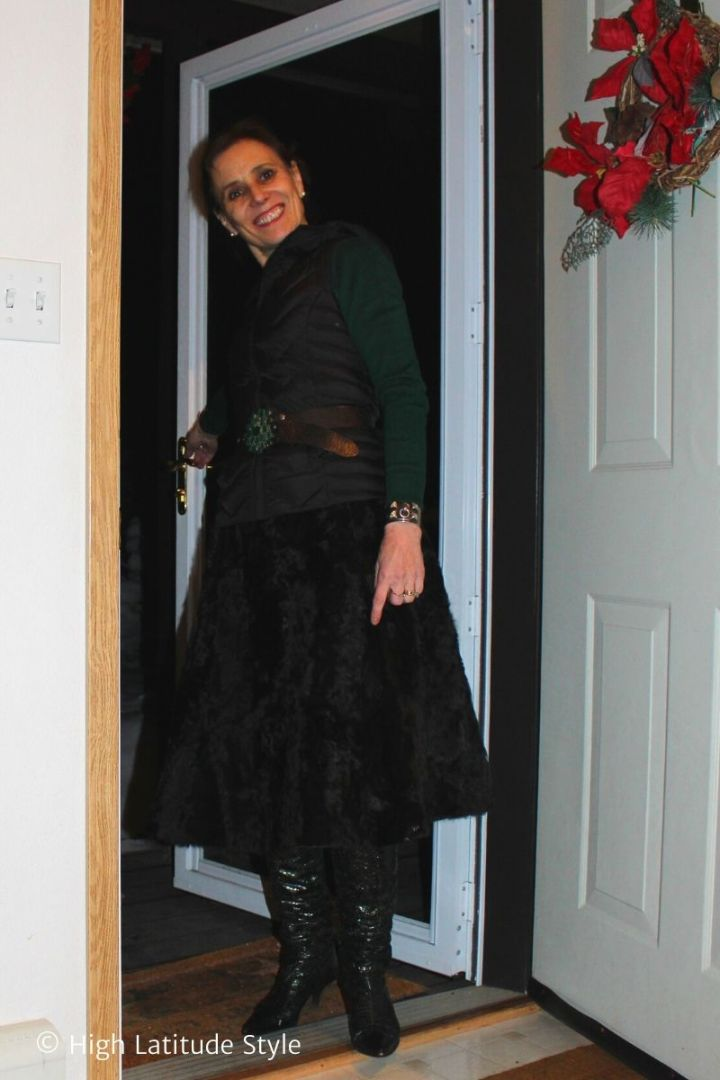 fashion blogger in fur skirt, cashmere sweater, snake boots, statement belt with emerald buckle