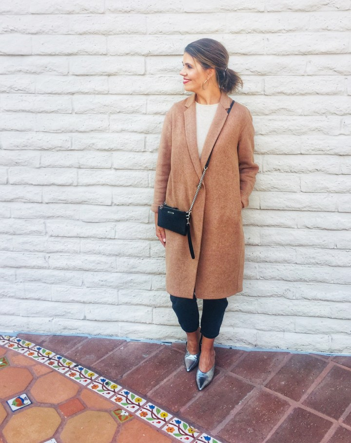 Suzanne Bell in posh casual Teddy coat, dress pants, T-shirt, silver pumps