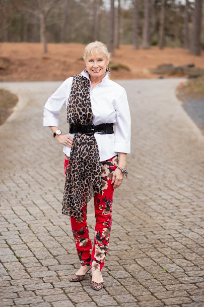 Robin LaMonte in floral pants with leopard print scarf and pumps for Vday