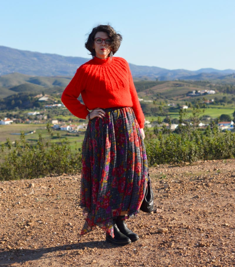 Top of the World OOTD Readers' Fav Suzy Turner in warm red knit sweater, combat boots, flowy maxi floral skirt