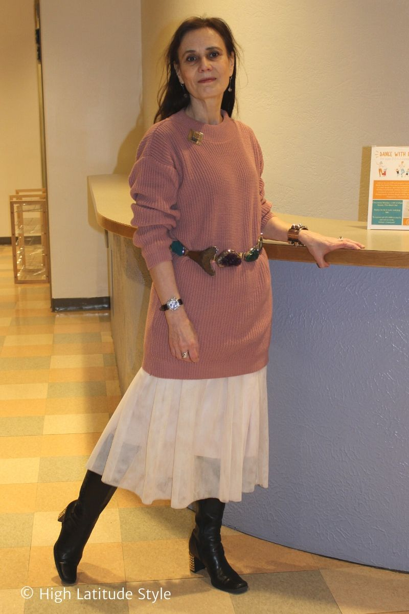 Nicole of High Latitude Style in dropped waist skirt, top, belt, tall embelished heels boots