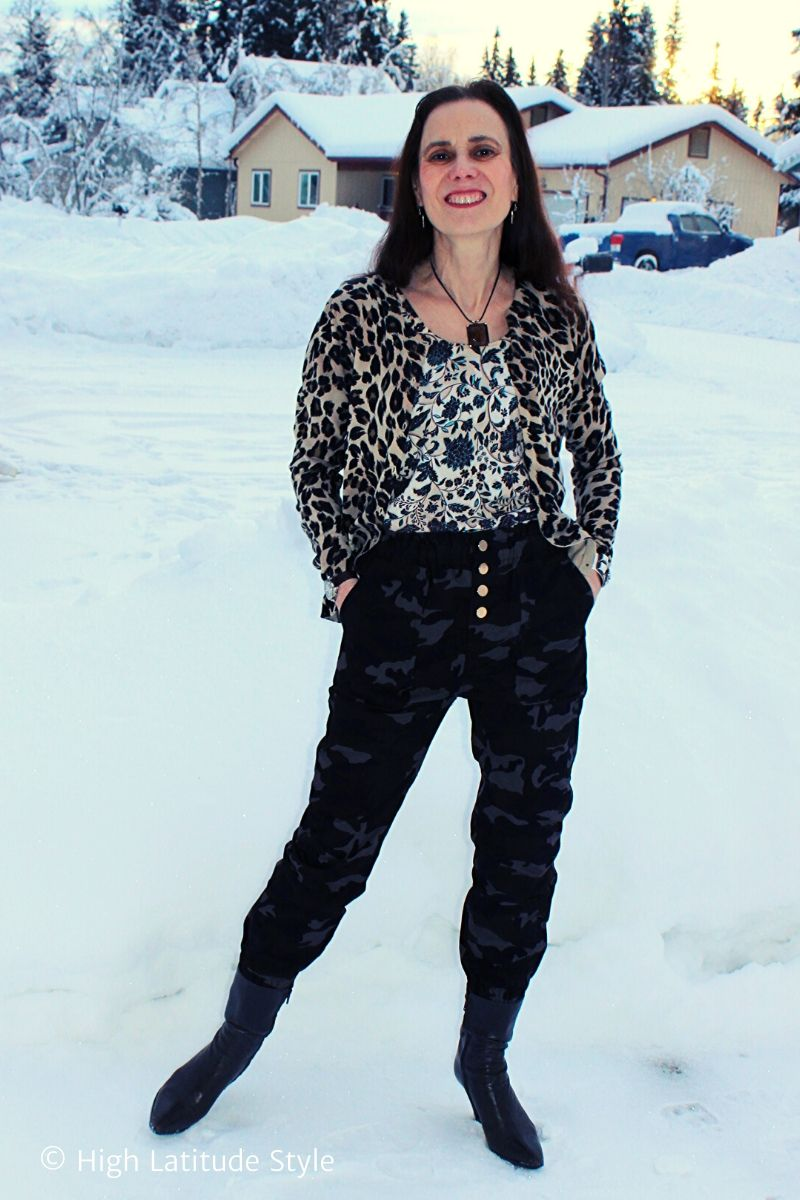 style blogger in mixed prints of floral, leopard and camo
