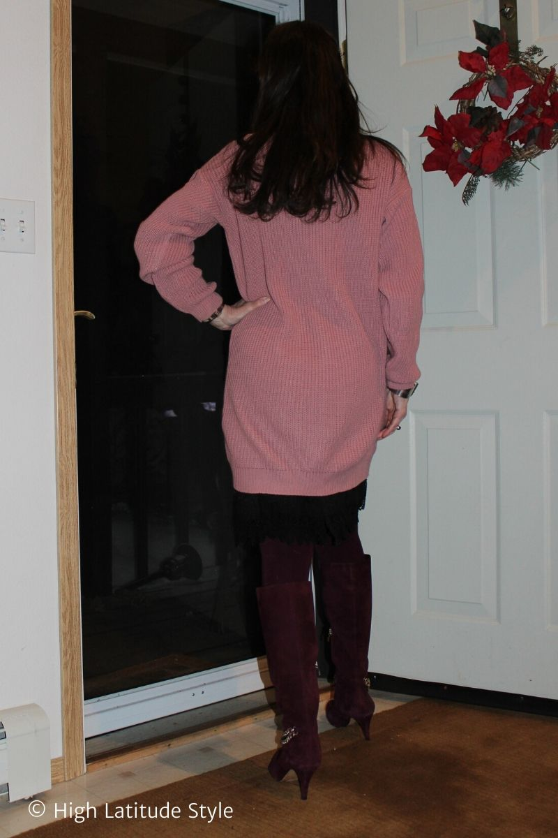 style book author in burgundy muted pink mixed fabrics dress look