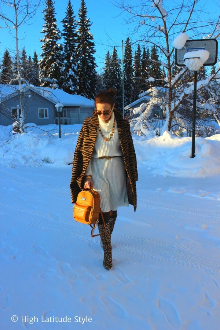 style blogger in mixed animal print, knit dress, necklace, belt, tall boots and JORD vegan backpack