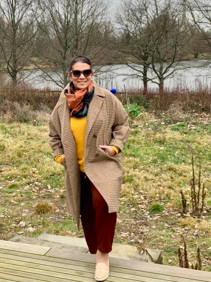 Top of the World OOTD Readers' Fav Claudia Lasetzki in plaid oversize winter coat, burgundy pants, yellow sweater