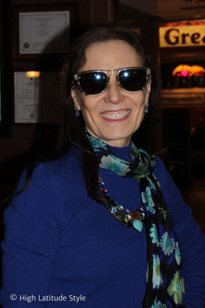 over 50 years old woman showing off her new MessyWeekend sunglasses to friends at a lunch place