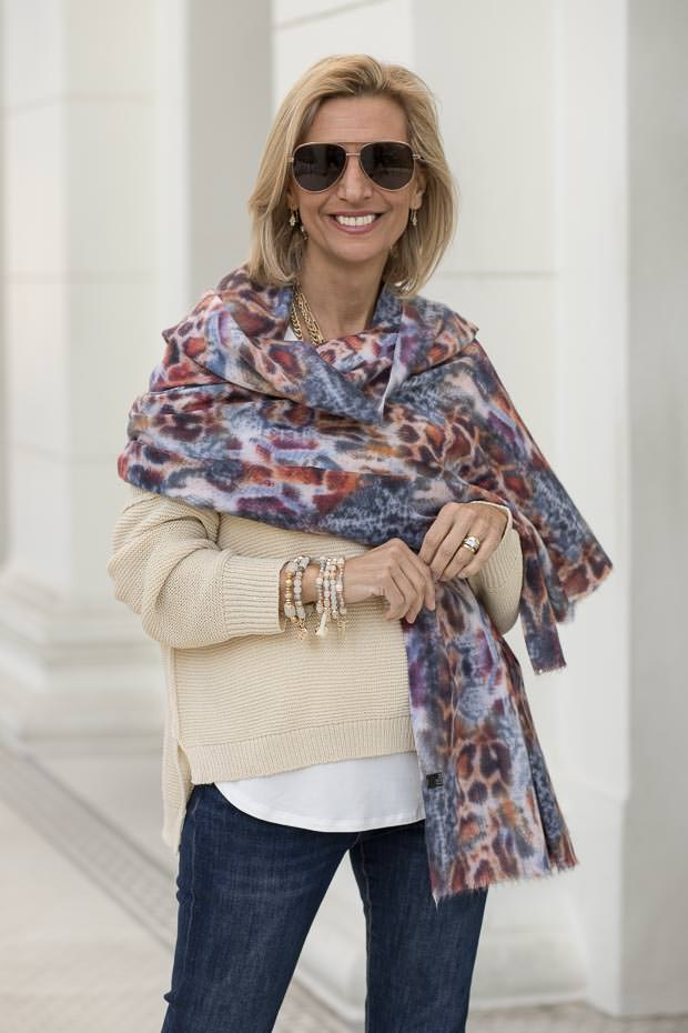 Top of the World Style Winner in great layering of sweater, shirt, blanket shawl with jeans
