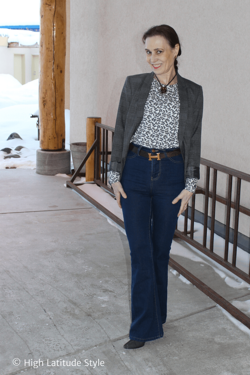 Alaskan woman in casual work outfit with jeans, jacket, printed top