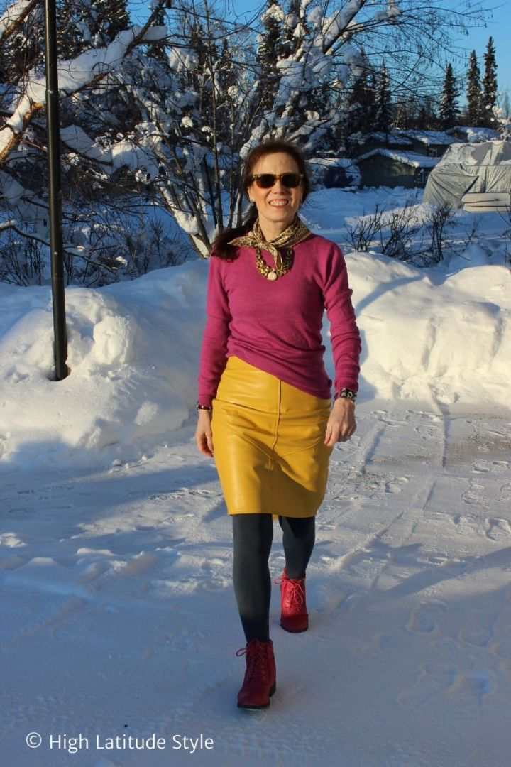 mature woman in pink sweater and shoes, yellow skirt
