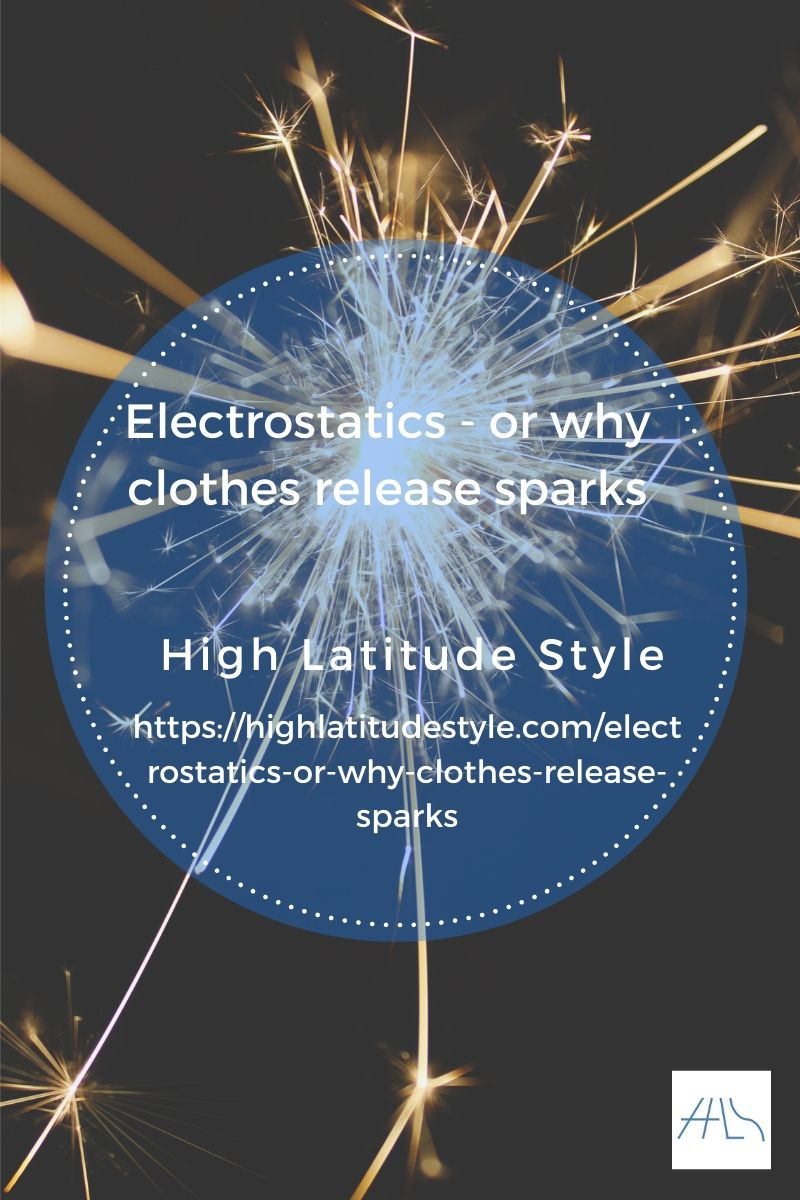 electrstatics why clothes release sparks post banner showing a spark in the dark