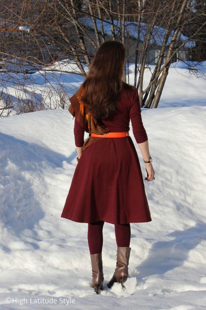 Alaskan satdning outside in spring in the snow in the sun