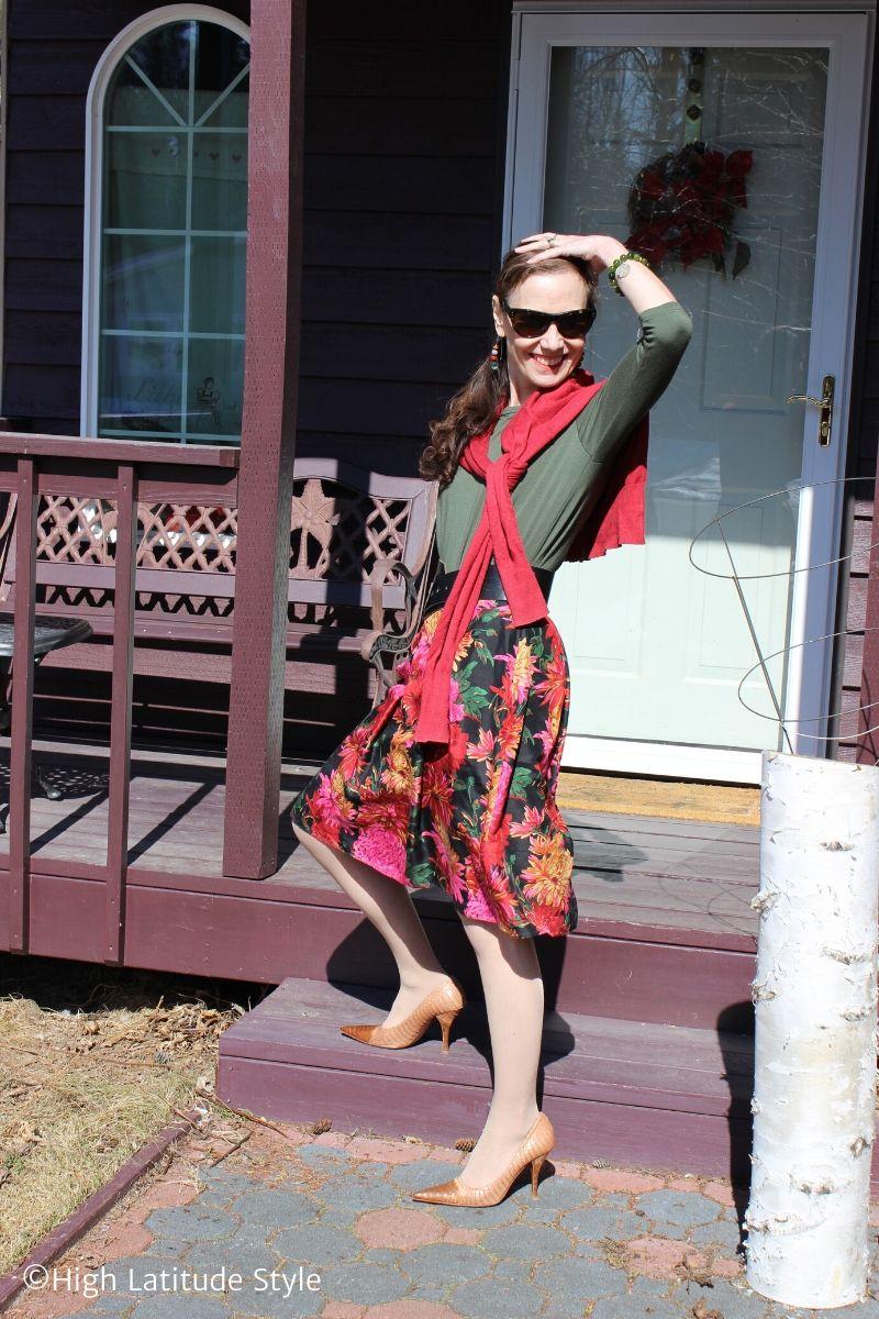 red knit jacket, flower print full skirt, olive 3/4 sleeve top, nude heels