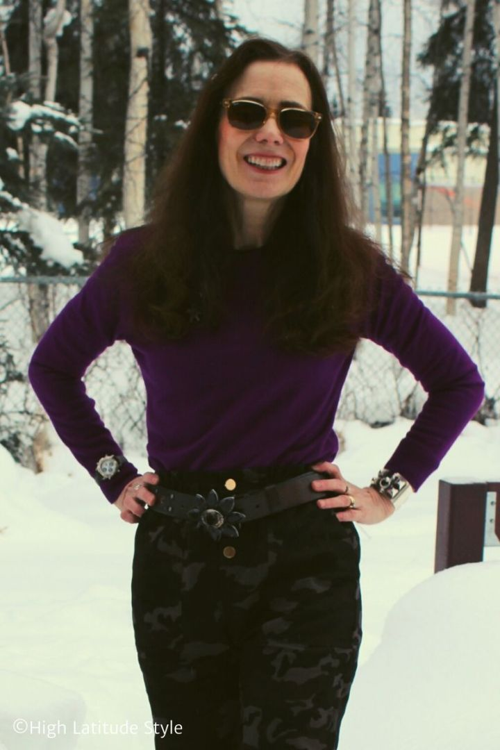 Alaskan fashion blogger in casual camo pants, purple sweater, sunnies and statement belt