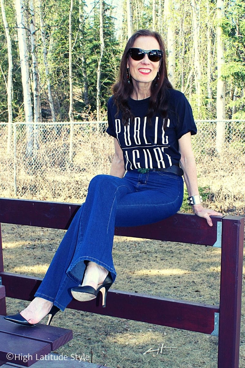 blogger Nicole in black heels and Public Figure top, flared jeans and self-made gemstone earrings