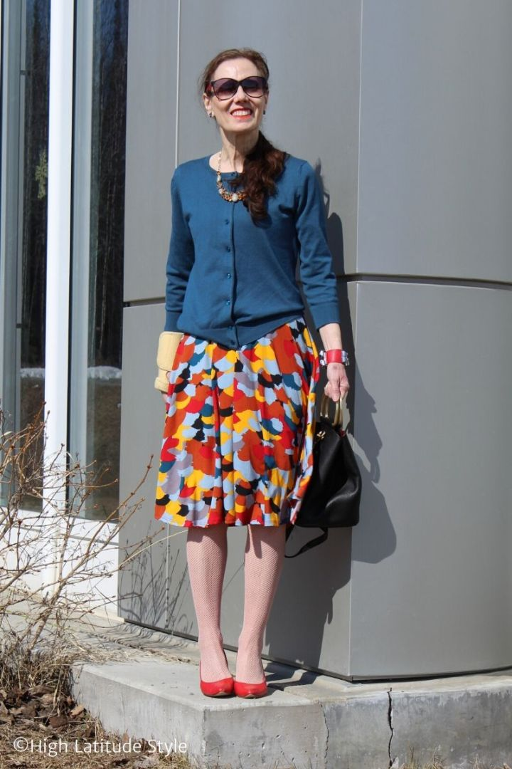 over 50 years old fashion blogger in fishnets, jacket and midi skirt