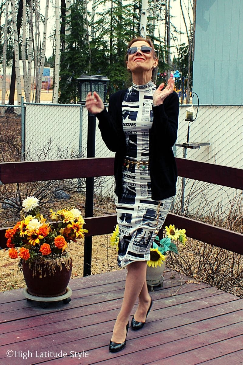 style blogger in newspaper print high neck sheath, patent leather pumps, rectangular sunglasses