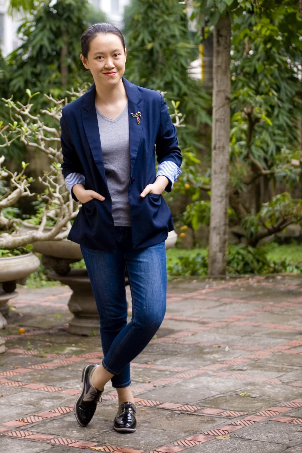 Salazar in grey top blue oversize blazer, loafers and jeans