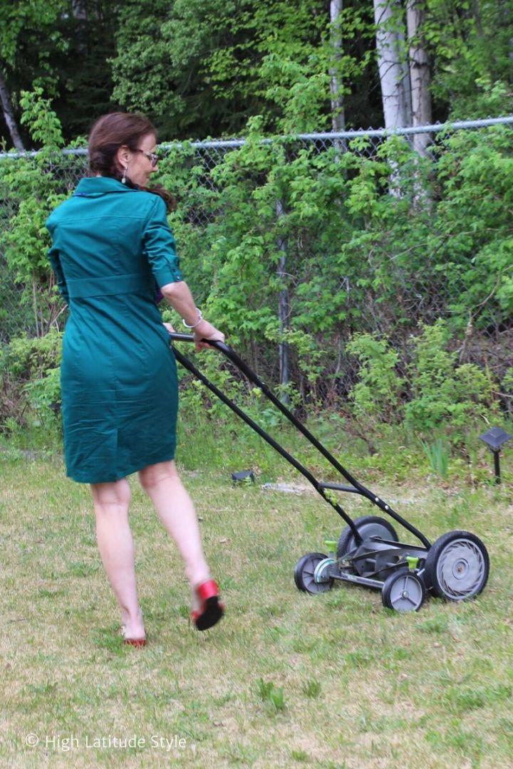 stylist turning a push mower