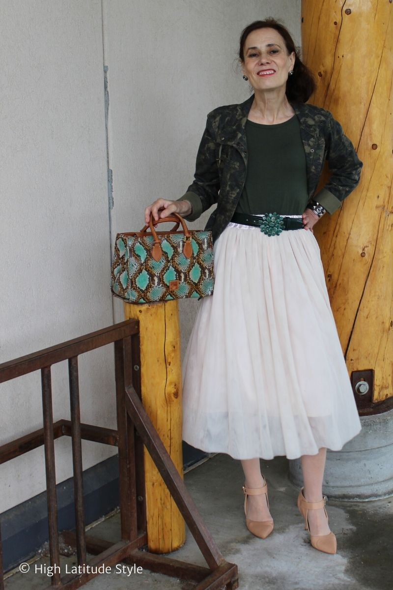 stylist in camouflage floral print jacket, blush tulle skirt