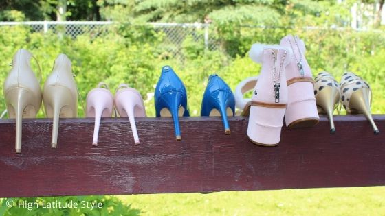 pumps placed on a railing to display their heel heights