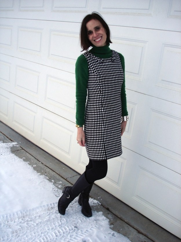 style blogger in hounds tooth sheath with green turtleneck, black tights and tall boots