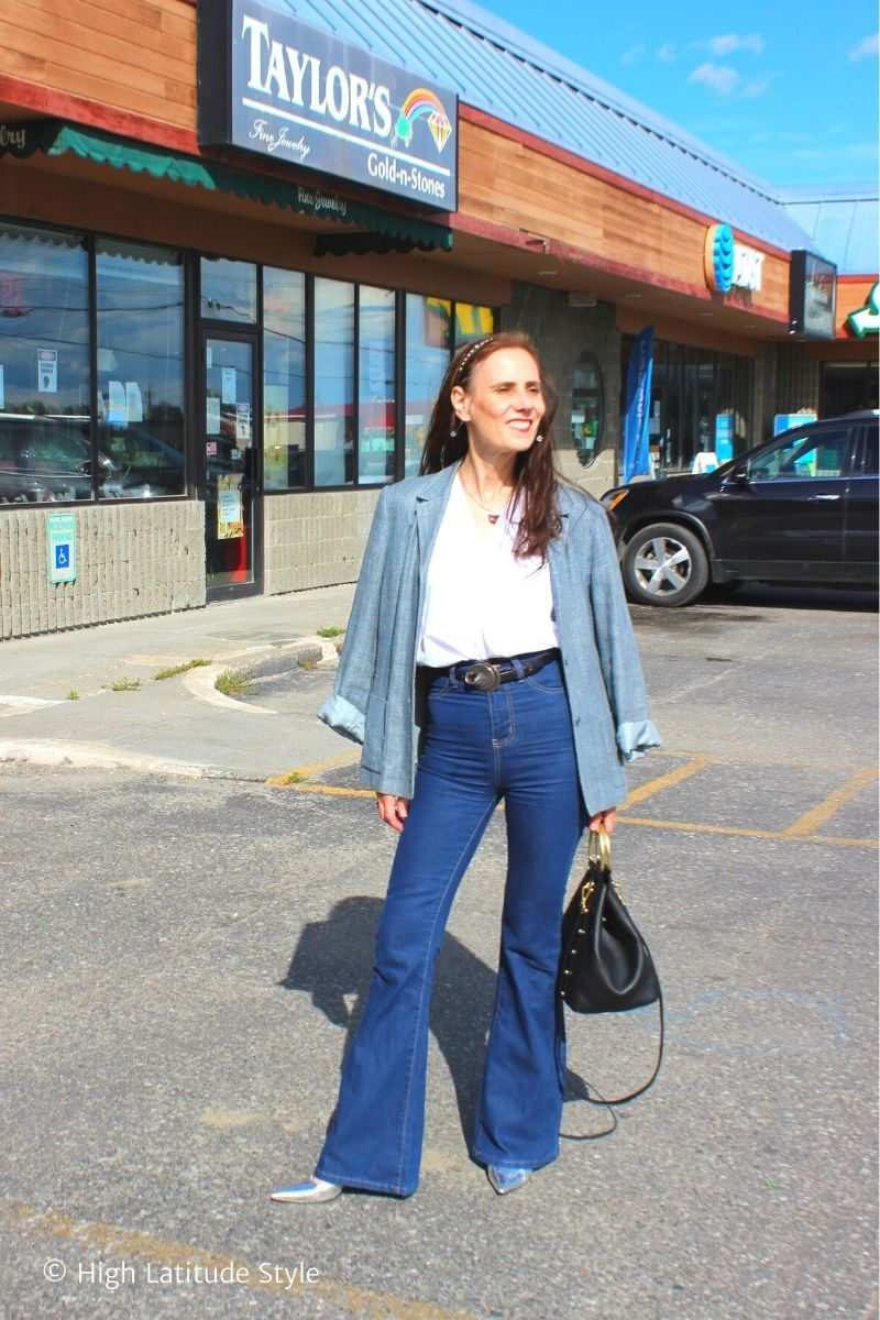 stylist in blue blazer, jeans, silver pumps, white top