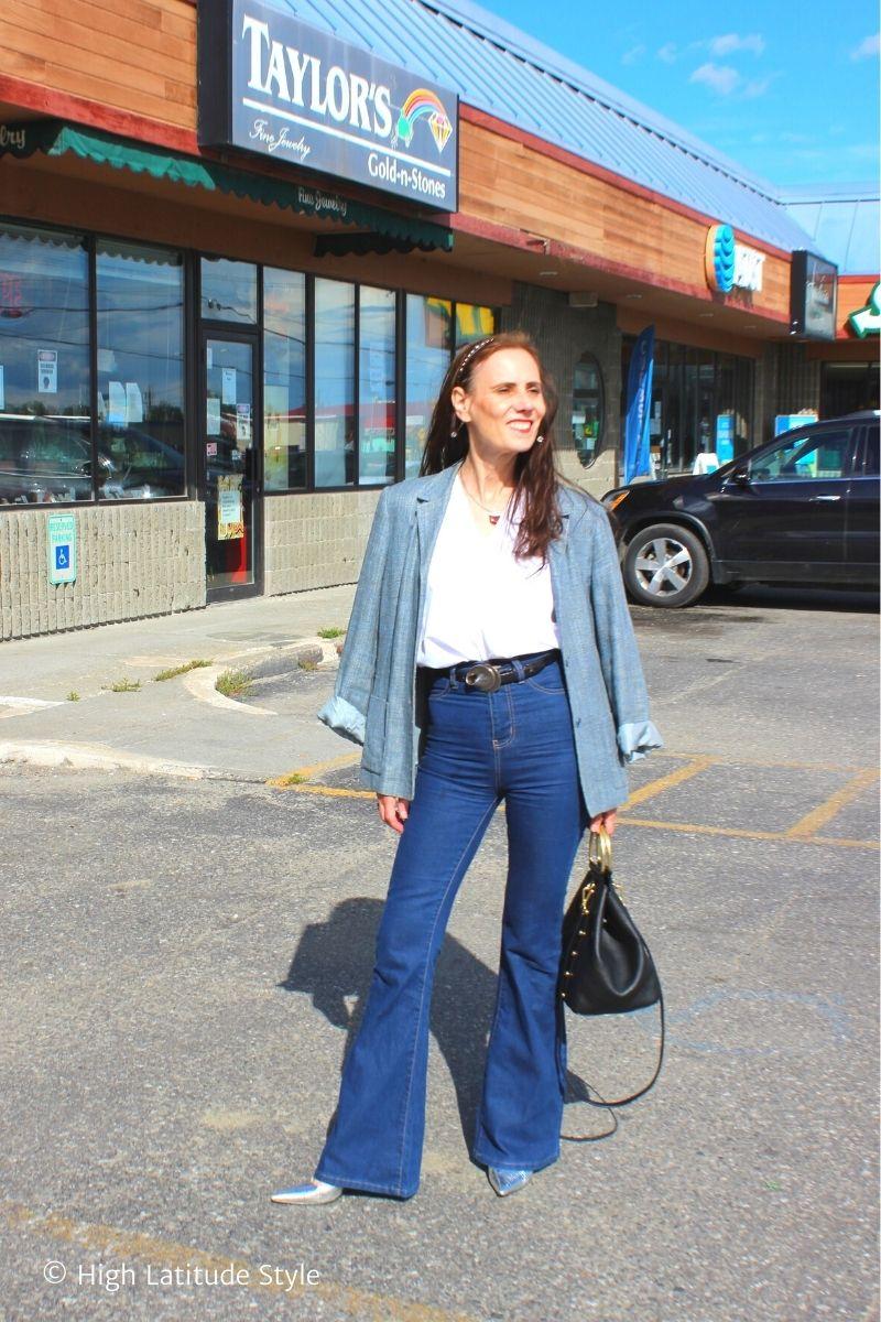 stylist in blue blazer, jeans, silver pumps, white top