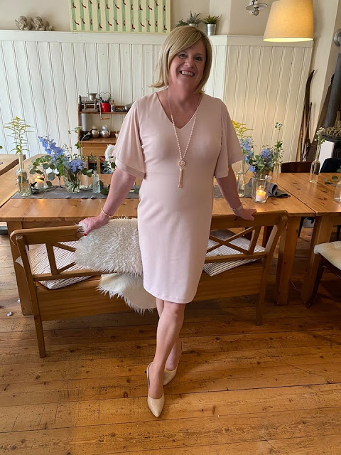 Nadine of crossdressing adventures in a blush pink dress